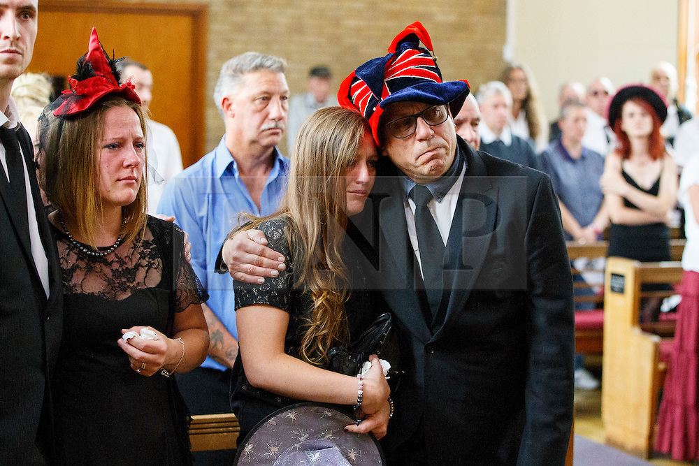 © Licensed to London News Pictures. 15/07/2015. Luton, UK. Friends and family attending Lorna Johnson's halloween themed funeral at Luton Crematorium in Luton on Wednesday, July 15, 2015. Lorna Johnson, 56 year old full time mother, loved halloween, fancy dresses and Star Wars and her family has requested that friends and family to attend her funeral wearing fancy dress. The Funeral Director, Brett Houghton of Co-op Funeralcare dressed up as Star Wars' Darth Vader. Photo credit: Tolga Akmen/LNP