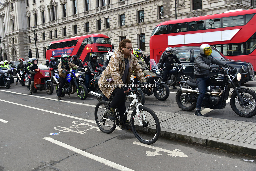 London, England, UK. 27 March 2018. We Ride London' protest rally against the marginalisation of motorcycles & scooters in London and the UK. Hoping  to make a change to the policies of Transport for London & the Mayor of London demand safety for ride and no charging to motorcycles & scooters £12.50 per day on 27 March 2018 at Parliament Square