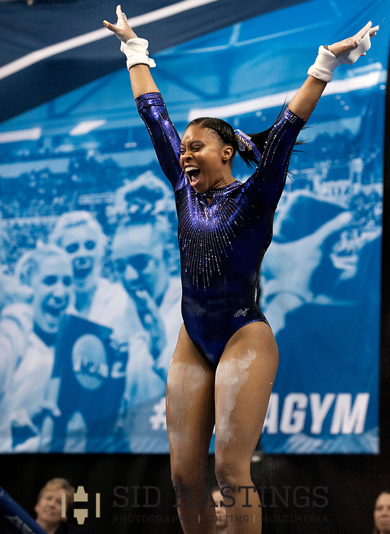 21 APRIL 2018 -- ST. LOUIS -- LSU gymnast Kennedi Edney celebrates after competing on the Uneven Parallel Bars during the 2018 NCAA Women's Gymnastics Championship Super Six at Chaifetz Arena in St. Louis Saturday, April 21, 2018.<br /> Photo &copy; copyright 2018 Sid Hastings.
