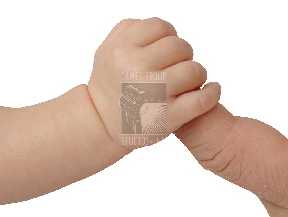 Hand of new born baby holding father's finger on white background with clipping path