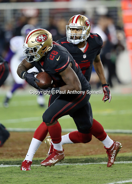 San Francisco 49ers quarterback Colin Kaepernick (7) hands off the ball to San Francisco 49ers running back Carlos Hyde (28) on a fourth quarter run for a first down during the 2015 NFL week 1 regular season football game against the Minnesota Vikings on Monday, Sept. 14, 2015 in Santa Clara, Calif. The 49ers won the game 20-3. (©Paul Anthony Spinelli)