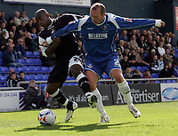 Photo: Paul Thomas.<br /> Oldham Athletic v Swansea City. Coca Cola League 1. 12/08/2006.<br /> <br /> Leon Knight (L) of Swansea is tackled by Simon Charlton.