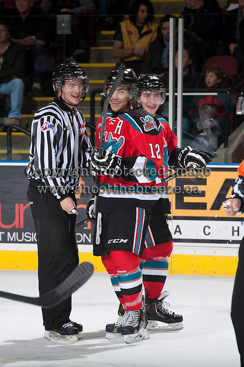KELOWNA, CANADA - DECEMBER 6: Tyrell Goulbourne #12 and Tyson Baillie #24 of the Kelowna Rockets share a laugh with the linesman on December 6, 2013 at Prospera Place in Kelowna, British Columbia, Canada.   (Photo by Marissa Baecker/Shoot the Breeze)  ***  Local Caption  ***