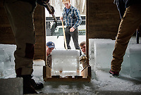 The crew of Neil Cederberg, Ryan Hambrook and Keegan Rasmussen unload blocks of ice into the Rockywold Ice House during RDC's annual ice harvest on Tuesday.  ©2018 Karen Bobotas Photographer