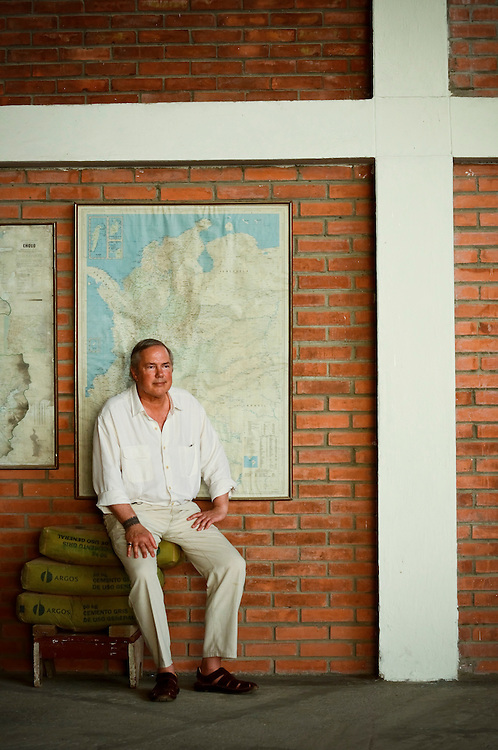 Gordon Radley, 64, poses for a portrait underneath a map of Chocó, at an airplane hanger in Quibdó, Colombia. Radley's brother, Lawrence, died in a plane crash in Chocó in 1962.