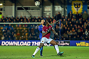 AFC Wimbledon defender Rod McDonald (26) battles for possession with AFC Wimbledon defender Paul Kalambayi (30) during the The FA Cup match between AFC Wimbledon and West Ham United at the Cherry Red Records Stadium, Kingston, England on 26 January 2019.