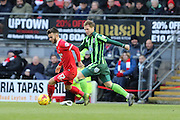 Dannie Bulman of AFC Wimbledon and Jack Payne of Leyton Orient during Sky Bet League 2 match between Leyton Orient and AFC Wimbledon at the Matchroom Stadium, London, England on 28 November 2015. Photo by Stuart Butcher.