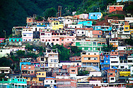 Colorful houses on a hillside in La Guaria, Venezuela.