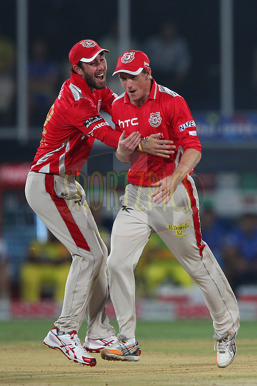 George BAILEY (Captain) of the Kings XI Punjab celebrates the wicket of Suresh RAINA of the Chennai Superkings with Glenn MAXWELL of the Kings XI Punjab  during the second semi final match of the Oppo Champions League Twenty20 between the Kings XI Punjab and the Chennai Superkings held at the Rajiv Gandhi Cricket Stadium, Hyderabad, India on the 2nd October 2014<br /> <br /> Photo by:  Ron Gaunt / Sportzpics/ CLT20<br /> <br /> <br /> Image use is subject to the terms and conditions as laid out by the BCCI/ CLT20.  The terms and conditions can be downloaded here:<br /> <br /> http://sportzpics.photoshelter.com/gallery/CLT20-Image-Terms-and-Conditions-2014/G0000IfNJn535VPU/C0000QhhKadWcjYs