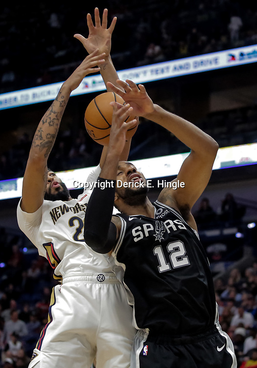 Nov 19, 2018; New Orleans, LA, USA; New Orleans Pelicans forward Anthony Davis (23) and San Antonio Spurs forward LaMarcus Aldridge (12) battle for a rebound during the second half at the Smoothie King Center. Mandatory Credit: Derick E. Hingle-USA TODAY Sports