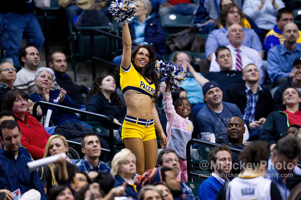 Feb. 28, 2012; Indianapolis, IN, USA; An Indiana Pacers cheerleader performs on the court during a timeout against the Golden State Warriors at Bankers Life Fieldhouse. Indiana defeated Golden State 102-78. Mandatory credit: Michael Hickey-US PRESSWIRE