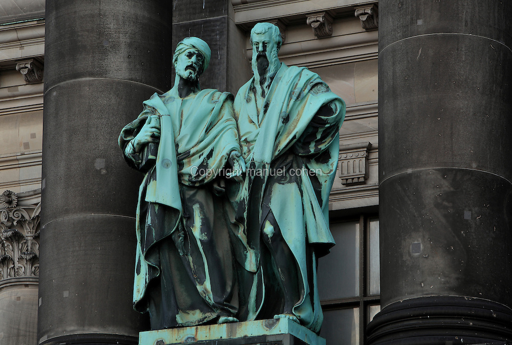 Statue of the evangelists Matthew and Mark on the facade of the Berliner Dom or Berlin Cathedral, redesigned by Julius Raschdorff and completed 1905 in Historicist style after being badly damaged in World War Two, although the original chapel on this site was consecrated in 1454, Museum Island, Mitte, Berlin, Germany. The buildings on Museum Island were listed as a UNESCO World Heritage Site in 1999. Picture by Manuel Cohen