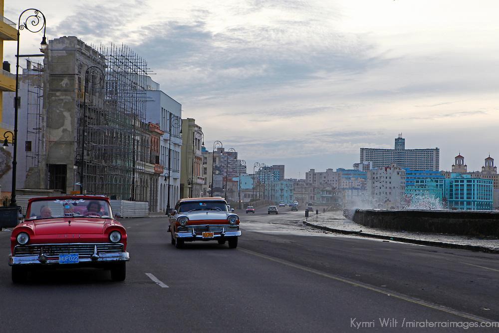 Central America, Cuba, Havana. Classic cars on the malecon, Havana, Cuba.