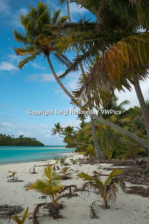 """Aitutaki. Cook Island. Polynesia. South Pacific Ocean. Beach in One Foot Island. One Foot Island is asmall island in the district of Aitutaki of the Cook Islands in Australia. It is also known as Tapuaetai and is one of 22 islands of the atoll. You can only reach this island via a short boat trip from the main island. It is said that One Foot Island gives the visitors the best view of the Aitutaki lagoon. It was awarded """"Australia's Leading Beach"""" at the World Travel Awards held in Sydney in June 2008. The island is uninhabited, but you can buy small things at the local shop. The beaches of OneFoot Island are white, and the water is crystal clear. This is not only a paradise for divers and snorkelers but also for those wanting to enjoy the beach and the sand. Climate: Since the islands are South of the equator, the seasons are opposite to those of Europe and North America. The cooler, drier season is from April to November and the warmer, more humid season is from December to March. The average temperature is 27 Celsius. Regularly listed as one of the most romantic places on Earth, and the second-most visited island in the Cooks, Aitutaki is famous for its impossibly crystal-clear, turquoise water of its central lagoon, tiny motus (islets) and pristine, palm-shaded beaches. Inland, Aitukati's rolling hills are a patchwork of banana plantations and coconut groves. 220 kilometres from Rarotonga and easily accessible by air, flying over Aitutaki is breathtaking. The immense, turquoise lagoon appears to float on the deeper blue of the Pacific, and is speckled with 15 uninhabited motus and brightly coloured corals just below the shimmering liquid surface. this is the ultimate blue lagoon. A leisurely walk to the summit of Aitutaki's highest peak, Maungapu, might only reach an elevation of a little over 120 metres, but it delivers sweeping views that are sure to leave you breathless. Another popular spot is the beautiful One Foot Island, where the TV show Survivor w"""