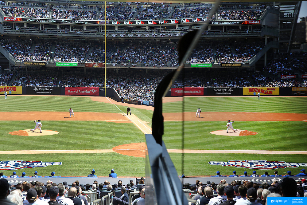 Masahiro Tanaka, New York Yankees, pitching during the New York Yankees Vs Toronto Blue Jays season opening day at Yankee Stadium, The Bronx, New York. 6th April 2015. Photo Tim Clayton