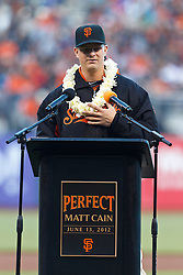 SAN FRANCISCO, CA - AUGUST 10: Matt Cain #18 of the San Francisco Giants speaks during a ceremony honoring his perfect game pitched on June 13, 2012 before the game against the Colorado Rockies at AT&T Park on August 10, 2012 in San Francisco, California. The Colorado Rockies defeated the San Francisco Giants 3-0. (Photo by Jason O. Watson/Getty Images) *** Local Caption *** Matt Cain