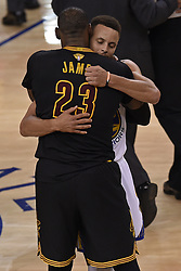 June 12, 2017 - Oakland, CA, USA - The Cleveland Cavaliers' LeBron James (23) congratulates Golden State Warriors' Stephen Curry at the conclusion of Game 5 of the NBA Finals at Oracle Arena in Oakland, Calif., on Monday, June 12, 2017. The Warriors clinched the series with a 129-120 victory. (Credit Image: © Jose Carlos Fajardo/TNS via ZUMA Wire)