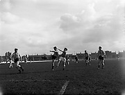 27/03/1960<br /> 03/27/1960<br /> 27 March 1960<br /> Soccer, League of Ireland: Limerick v Transport at Harold's Cross, Dublin. Doyle (Transport) manages to clear this ball despite the attentions of Wallace (Limerick) on right.