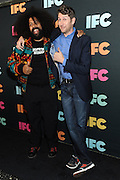 Reggie Watts, left, and Scott Aukerman, of Comedy Bang! Bang!, attend the IFC Upfront 2014 event, Thursday, March 20, 2014, at Roseland Ballroom in New York.  (Photo by Diane Bondareff/Invision for IFC/AP Images)