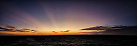 Indian Ocean Dawn Panorama from the deck of the MV World Odyssey. Clouds and Sun Beams. Composite of images taken with a Fuji X-T1 camera and 23 mm f/1.4 lens (ISO 200, 23 mm, f/2.8, 1/125 sec).