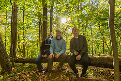 Three young men hang out in a forest in Amesbury, Massachusetts.