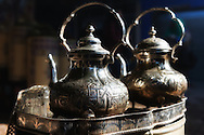 Traditional moroccan teapot with glasses in a tea tray. Medina of Marrakech, Morocco.