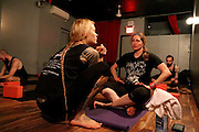 NEW YORK CITY, NEW YORK, MARCH 30, 2016. Caryn Havlik and instructor Saskia Thode during Metal Bones Yoga. The class takes place at 6:30 p.m. on Wednesdays at The Cobra Club in Bushwick, Brooklyn. 03/30/2016. Photo by Donna M. Airoldi/NYC News Service