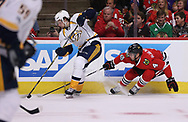 April 13, 2017 - Chicago, IL, USA - The Chicago Blackhawks' Niklas Hjalmarsson (4) tries to gain possession of the puck in the first period against the Nashville Predators during Game 1 in the first round of the playoffs at the United Center in Chicago on Thursday, April 13, 2017. (Credit Image: © Chris Sweda/TNS via ZUMA Wire)