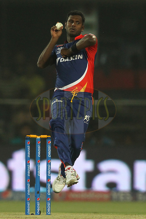 Angelo Mathews of the Delhi Daredevils sends down a delivery during match 21 of the Pepsi IPL 2015 (Indian Premier League) between The Delhi Daredevils and The Mumbai Indians held at the Ferozeshah Kotla stadium in Delhi, India on the 23rd April 2015.<br /> <br /> Photo by:  Shaun Roy / SPORTZPICS / IPL