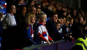 A young fan watches under floodlight during the Capital One Cup match between Crystal Palace and Charlton Athletic at Selhurst Park, London, England on 23 September 2015. Photo by Michael Hulf.