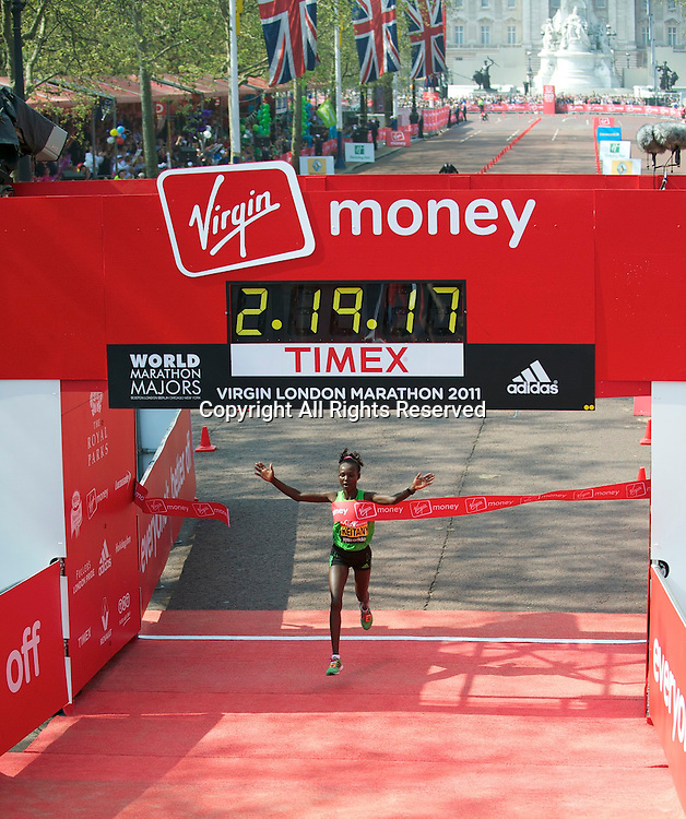 17.4.2011. Virgin London Marathon 2011. Mary Keitany of Kenya wins the Virgin London Marathon with a time of 2.19.17 at the finish line of The Virgin London Marathon at The Mall, London ,England