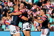 James Tedesco celebrates after scoring with Jared Waerea-Hargreaves and Cooper Cronk. Sydney Roosters v Vodafone Warriors. NRL Rugby League. Sydney Cricket Ground, Sydney, Australia. 18th August 2019. Copyright Photo: David Neilson / www.photosport.nz