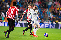 Real Madrid's Gareth Bale and Athletic de Bilbao's Iñaki Williams and Enric Saborit during La Liga Match at Santiago Bernabeu Stadium in Madrid. October 23, 2016. (ALTERPHOTOS/Borja B.Hojas)