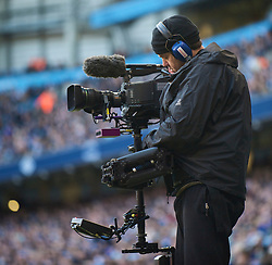 MANCHESTER, ENGLAND - Sunday, January 31, 2010: A television cameraman uses a steadycam to cover the Premiership match between Manchester City and Portsmouth at the City of Manchester Stadium. (Photo by David Rawcliffe/Propaganda)