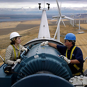 [wind farm]..Caption:.Project manager Terry Meade explains the parts of a wind .driven generator to fellow Energy Northwest employee Angela .Curtis atop a wind turbine tower 300 fet above farmland near .Kennewick, Washington on Wednesday, September 10, 2003. The .towers are nearly 300 feet tall with 100 foot long blades. Energy .Northwest, operator of the wind farm, also runs the nearby .Columbia Nuclear Generating Station Joshua Trujillo / Seattle .Post-Intelligencer..Photographer:.Joshua Trujillo..Title:.Staff Photographer..Credit:.Seattle Post-Intelligencer..City:.Kennewick..State:.WA..Country:.USA..Date:.20030910..ObjectName:.wind farm..CaptionWriter:.jt..Special:.DIGITAL..Source:.Seattle Post-Intelligencer