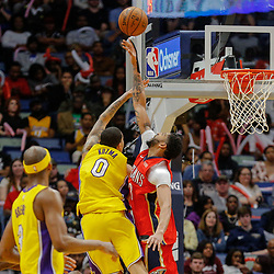 Feb 14, 2018; New Orleans, LA, USA; New Orleans Pelicans forward Anthony Davis (23) blocks a shot by Los Angeles Lakers forward Kyle Kuzma (0) during the second half at the Smoothie King Center. The Pelicans defeated the Lakers 139-117. Mandatory Credit: Derick E. Hingle-USA TODAY Sports