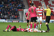 Gabriel Zakuani (5) of Peterborough United and Nathan Tyson (14) of Doncaster Rovers  colide together and the ref calls for assistance during the Sky Bet League 1 match between Doncaster Rovers and Peterborough United at the Keepmoat Stadium, Doncaster, England on 19 March 2016. Photo by Ian Lyall.