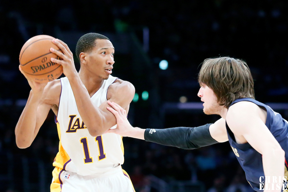 07 December 2014: Los Angeles Lakers forward Wesley Johnson (11) looks to pass over New Orleans Pelicans forward Luke Babbitt (8) during the New Orleans Pelicans 104-87 victory over the Los Angeles Lakers, at the Staples Center, Los Angeles, California, USA.
