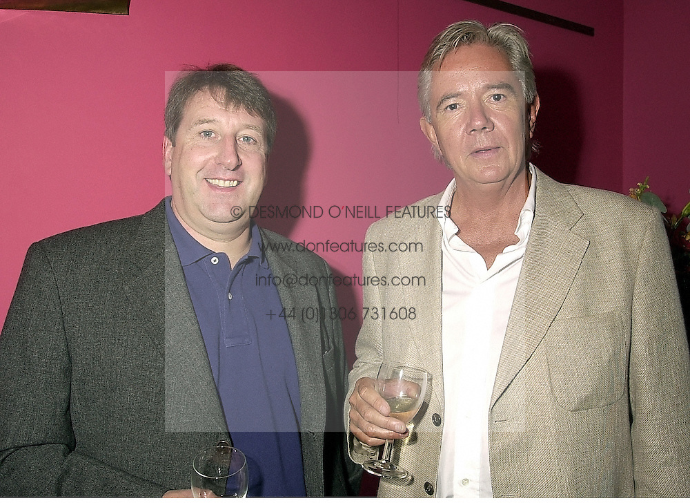 Left to right, tv & radio presenter RICHARD LITTLEJOHN and MR CHARLES CATCHPOLE, at a reception in London on 21st August 2000.OGS 30