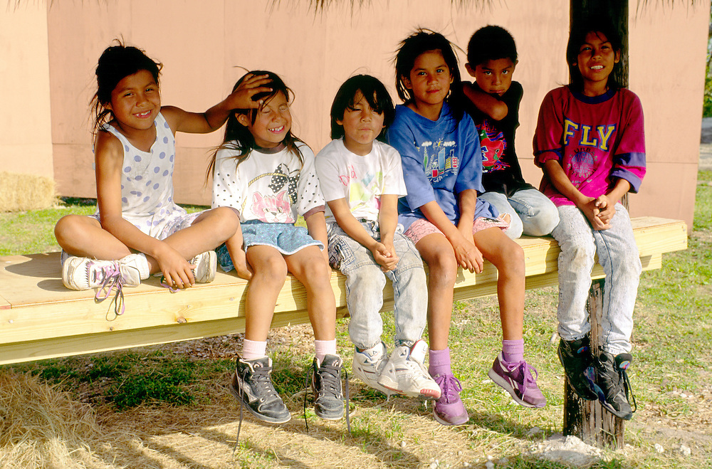 Children of the Miccosukee native American Indian tribe in their homeland reservation in Dade County, Florida Everglades, USA