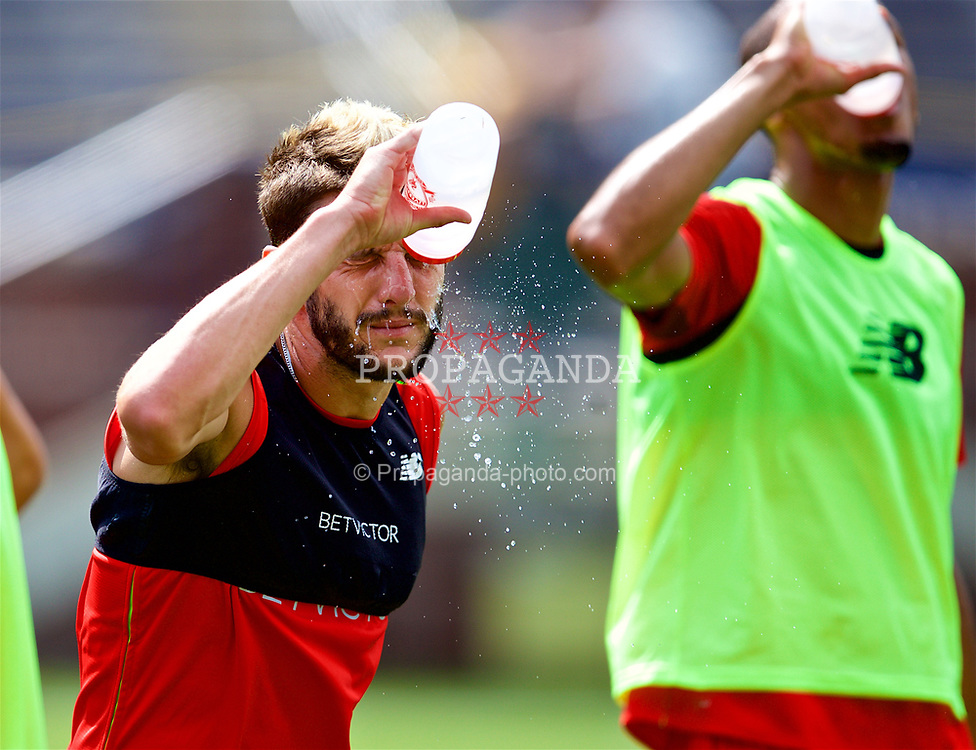 ANN ARBOR, USA - Friday, July 27, 2018: Liverpool's Adam Lallana pours water onto his face during a training session ahead of the preseason International Champions Cup match between Manchester United FC and Liverpool FC at the Michigan Stadium. (Pic by David Rawcliffe/Propaganda)