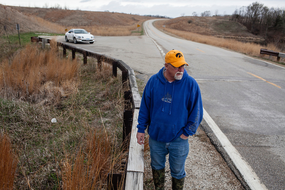 Mike Johnson examines the Brushy Creek dam on Wednesday, March 21, 2012 in Lehigh, IA.