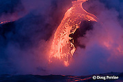 red hot lava from the ongoing eruption of Kilauea Volcano pours into the ocean at Waikupanaha, Hawaii, near Kalapana in Hawaii Volcanoes National Park on the Big Island of Hawaii ( Central Pacific Ocean )