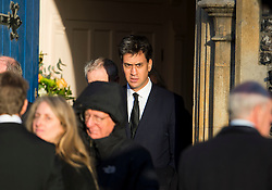 © Licensed to London News Pictures. 13/11/2015. London, UK. Former Labour party leader ED MILIBAND after The funeral of former Labour MP Michael Meacher at St Mary's Church in Wimbledon, south west London.  Michael Meacher, who was a Labour MP in Oldham for over 40 years, served as Minister of State for the Environment in the Tony Blair government.  Photo credit: Ben Cawthra/LNP