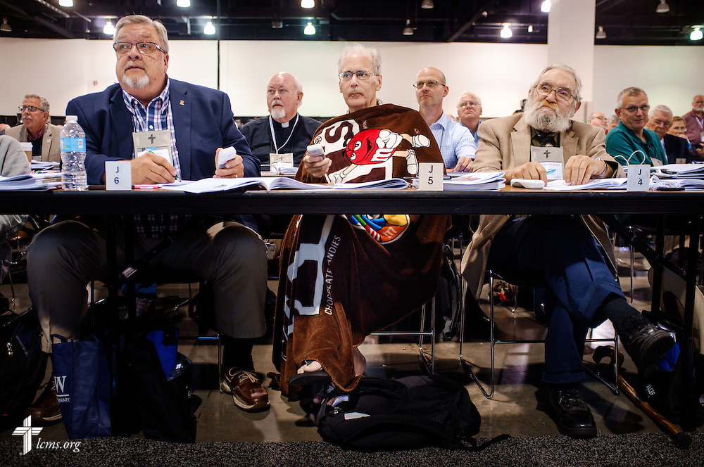 Bill Carney, a voting delegate from the California/Nevada/Hawaii District, warms up with a blanket as he prepares to vote during elections on Tuesday, July 12, 2016, at the 66th Regular Convention of The Lutheran Church–Missouri Synod, in Milwaukee. LCMS/Erik M. Lunsford