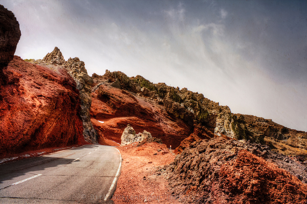 The road LP4 on Madeira leading through the red rocks of the mountains
