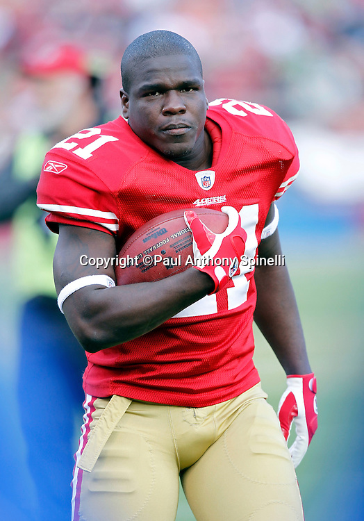 San Francisco 49ers running back Frank Gore (21) holds the ball during a break in the action at the NFL week 11 football game against the Tampa Bay Buccaneers on Sunday, November 21, 2010 in San Francisco, California. The Bucs won the game 21-0. (©Paul Anthony Spinelli)
