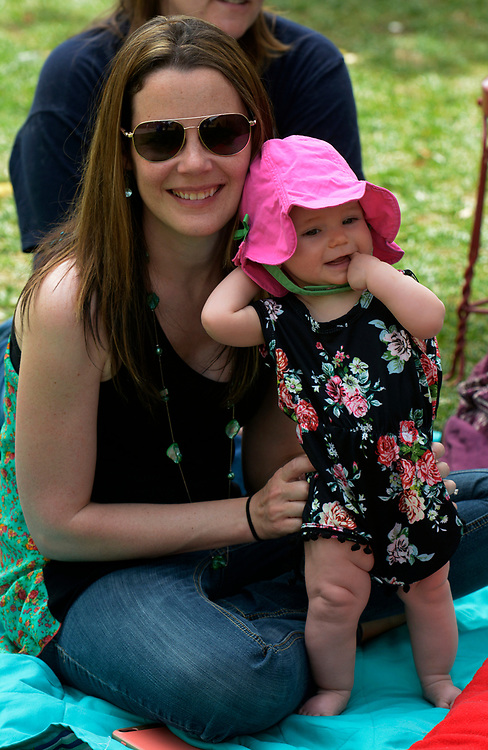 gbs051417k/ASEC -- Rochelle Reed of Albuquerque and her 8-month-old daughter, Emily, listen to the New Mexico Philharmonic during the Mother's Day Concert at the Zoo on Sunday, May 14, 2017. (Greg Sorber/Albuquerque Journal)