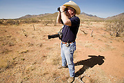 02 APRIL 2006 - THREE POINTS, AZ: DON GOLDWATER, who ran as a Republican candidate for the Governor of Arizona and nephew of late US Senator and conservative icon Barry Goldwater, staffs his observation post during the Minuteman Project action between Three Points, AZ, and Sasabe, AZ, about 50 miles south of Tucson, AZ, April, 2, 2006. This is the second Minuteman action Goldwater has participated in. He is positioning himself as the anti-illegal gubernatorial candidate in the 2006 election. Volunteers from the Minuteman Project have set up lines of observation posts on remote county roads in the desert southwest of Tucson to monitor the area for illegal immigrant traffic. On Saturday night, the first night of the action, Minuteman volunteers spotted more than 50 illegal immigrants and claim their tips to the US Border Patrol led to the apprehension of at least 16 of those immigrants.  Photo by Jack Kurtz