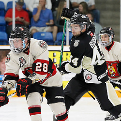 TRENTON, ON - SEP 8:  Todd Winder #28 of the Newmarket Hurricanes skates with the puck while being pursued by Nick Boddy #44 of the Trenton Golden Hawks during the OJHL regular season game between the Newmarket Hurricanes and Trenton Golden Hawks on September 8, 2016 in Trenton, Ontario. (Photo by Amy Deroche/OJHL Images)